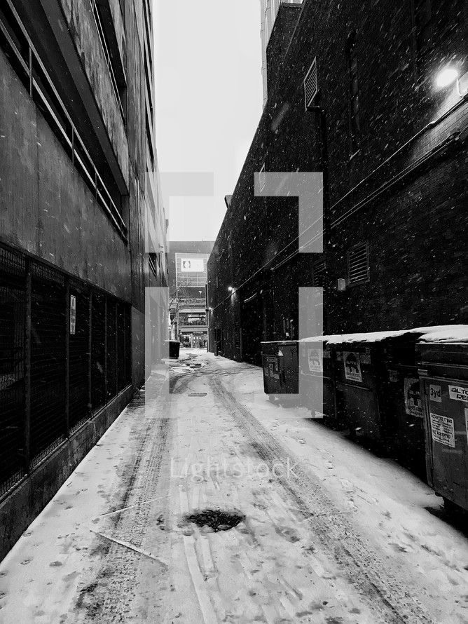 snow falling in an alley