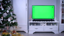 Green screen on a tv and Christmas tree