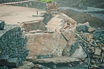 broken wall along a shore in Tenerife, Spain