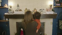 a child admiring a Christmas display