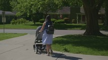 a mother pushing a stroller