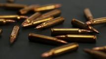 falling bullets on black background.