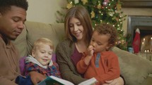 a family reading Christmas books