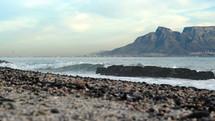 waves crashing into a shore at Table Mountain