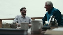 elderly man mentoring a young man