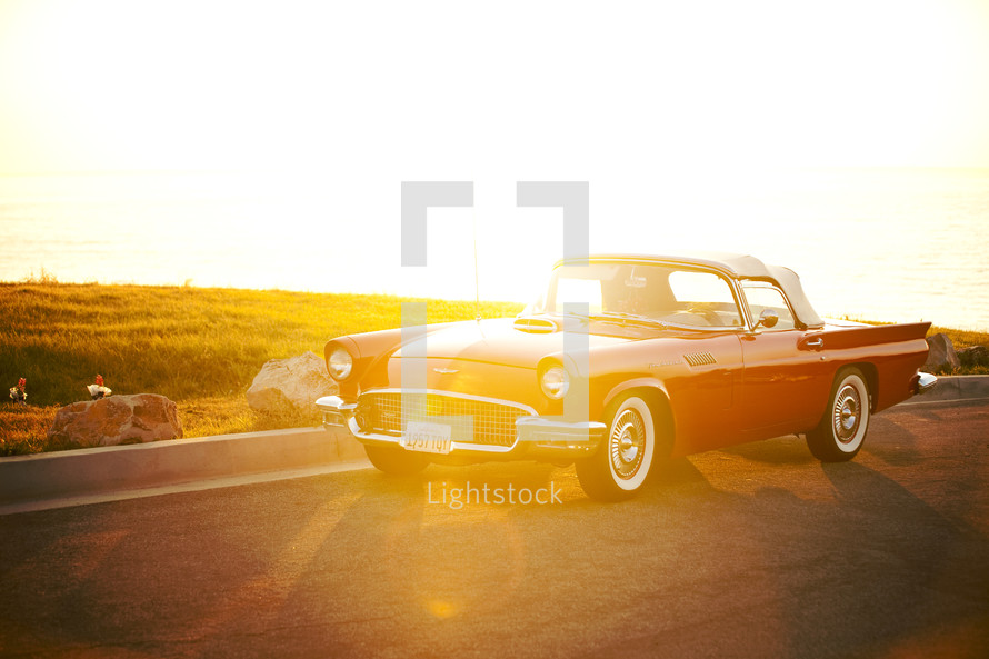 vintage Thunderbird on highway - sunburst on car