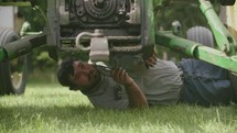 a farmer working on a tractor