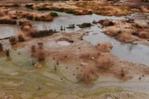 puddles on a muddy landscape
