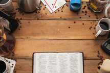 Bible surrounded by coffee shop items