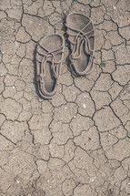Jesus' shoes on parched soil