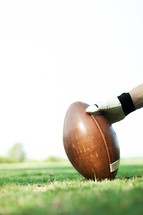 football player holding a football