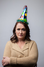 angry woman in a party hat