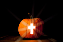 cross carved in a Jack-O-Lantern