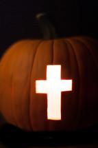 Light of the world pumpkin with cross of Jesus - cross carved in a Jack-O-Lantern pumpkin