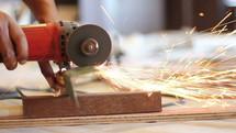 a grinder making sparks