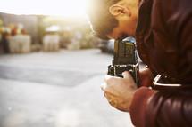 Man looking through a box camera
