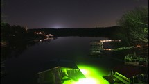 glow of lights from a boat house at night