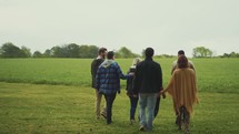 group walking together in a field