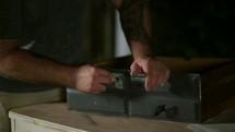a man refurbishing a table
