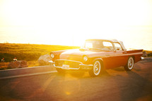 vintage Thunderbird on highway - sunburst on car