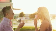 a couple eating ice cream cones on a date