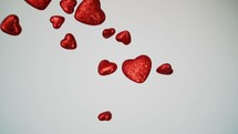 falling red hearts on white background.