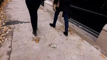 walking on a sidewalk in Chicago