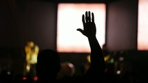 raised hand during a worship service