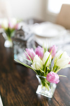tulips in a vase on a set table for Easter