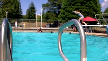 children on a diving board