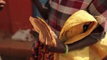 woman holding an old Bible in Uganda