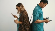 a couple distracted by phones