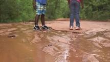 children exploring a canyon