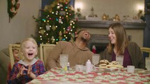 A family sitting at a table at Christmas