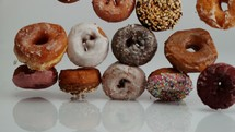 falling donuts on white background