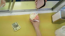a woman ordering an ice cream