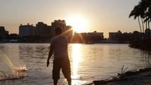 a man throwing a fishing net