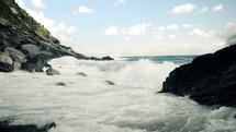 sea water crashing into rocks