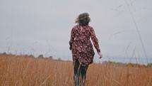 a woman running through a field