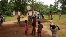 kids playing in a village in Uganda