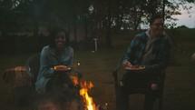 friends sitting around a fire pit