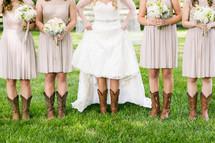 bride and bridesmaids wearing cowboy boots