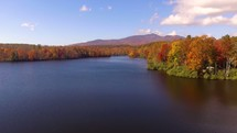 Drone flying over Price Lake in fall