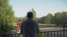 a man looking over a railing