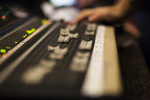 hand on a sound board
