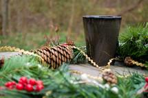 Christmas greenery and candle