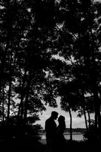 silhouette of a couple embracing