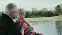 elderly couple talking outdoors