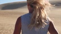 woman walking in a desert