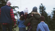 a family at a Christmas tree farm